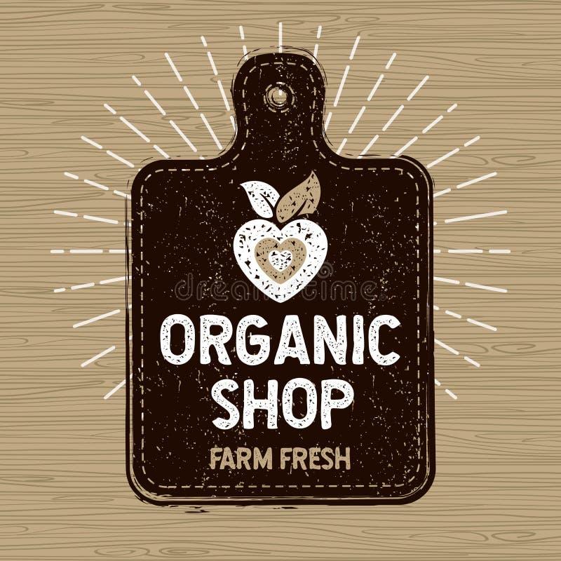 Het organische winkelembleem, bewerkt vers voedseletiket, scherpe raad, stralen, hout, elementen stock illustratie