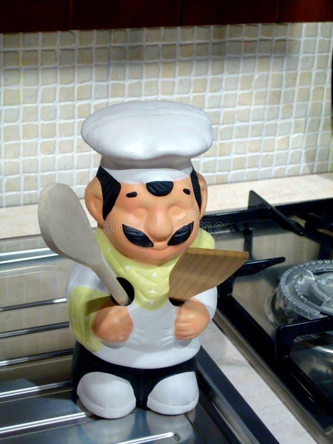 Het ornament van de chef-kok in keuken stock fotografie