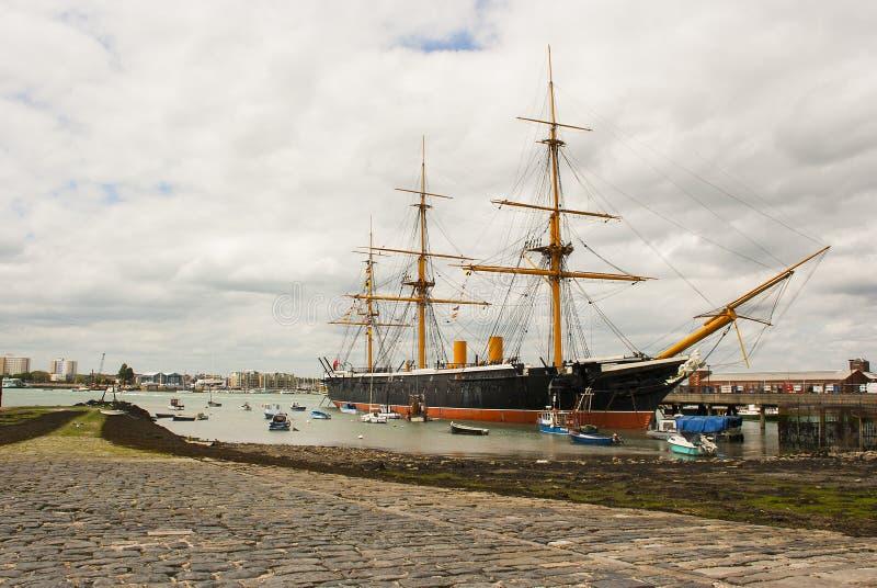 Het oude Koninklijke Zegevierende Marinefregat HMS het eerste ijzer beklede oorlogsschip in de Britse Marine en nu een drijvend m stock afbeeldingen
