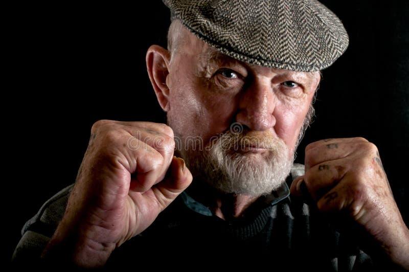 Het oude mens vechten stock afbeeldingen