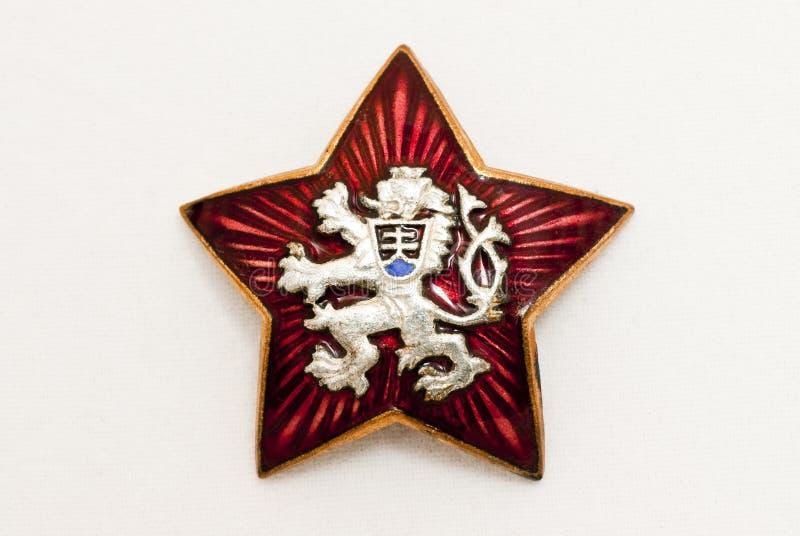 Het oude nationale symbool van Tsjecho-Slowakije in rode ster