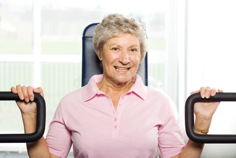 Het Oudere Vrouw Uitwerken Stock Foto
