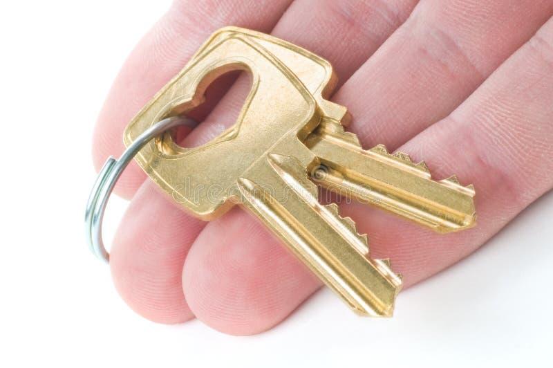 Het overhandigen sleutels stock foto's