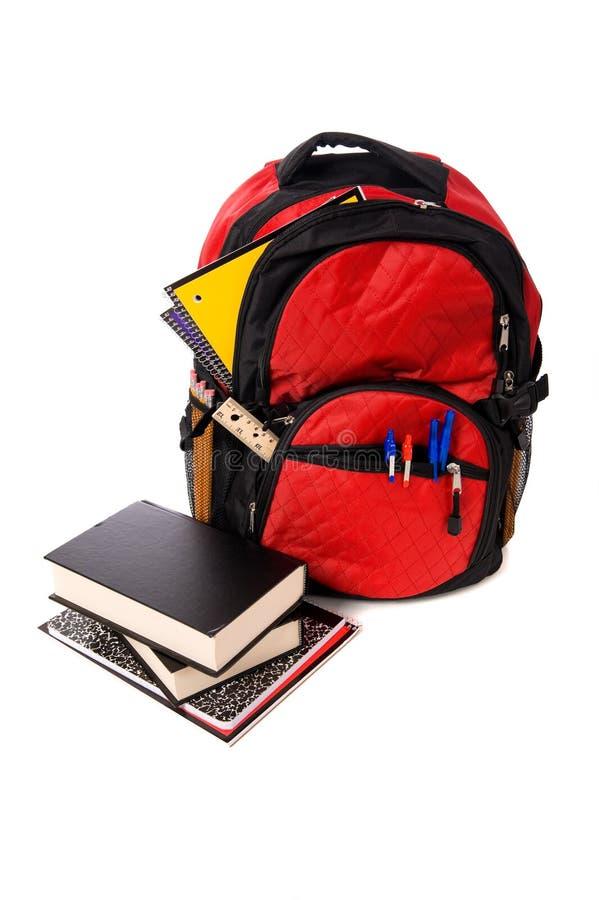 Download Het Overlopen Van De Rugzak Van De School Met Levering Stock Foto - Afbeelding bestaande uit learning, geïsoleerd: 10779422