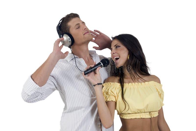 Het paar dat van de jeugd van muziek geniet royalty-vrije stock foto