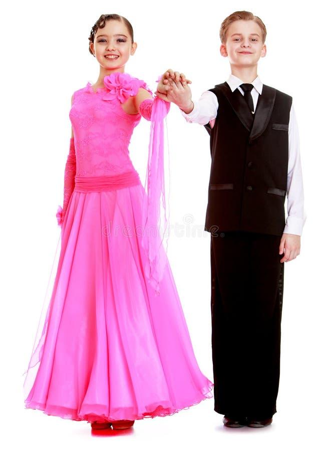 Het paar van de de jeugddans in mooie kostuums royalty-vrije stock afbeeldingen