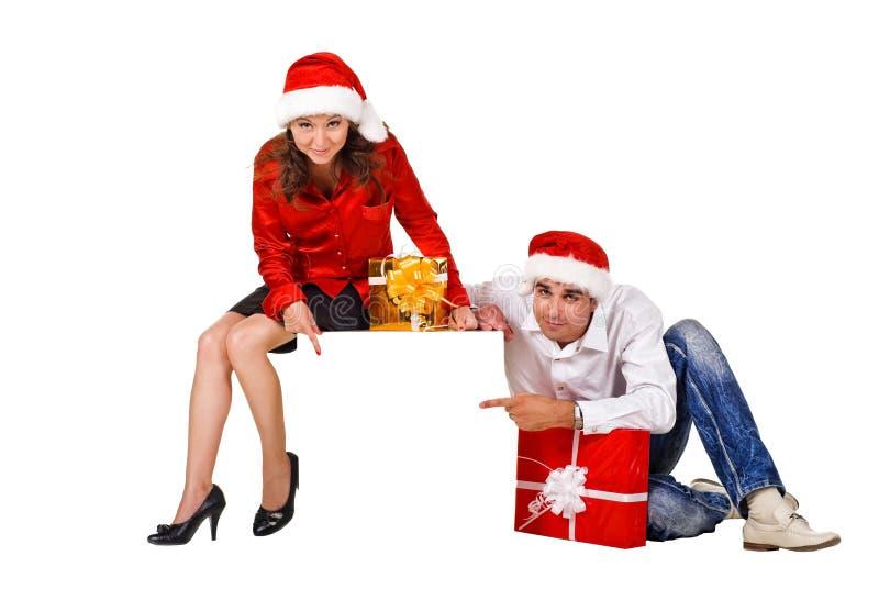 Het paar van Kerstmis met Leeg teken stock foto