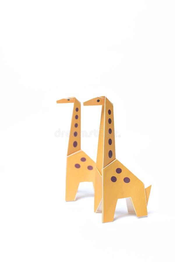 Het Paar van origamigiraffen van Geel stock foto's