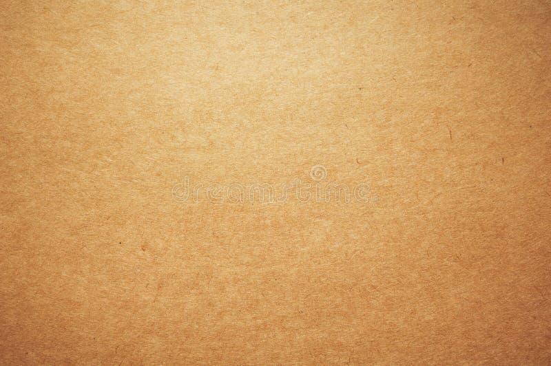 Het pakpapierachtergrond van kraftpapier stock afbeelding