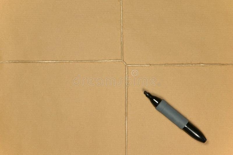 Het pakpapierpakket klopte met koord en pen. stock foto's