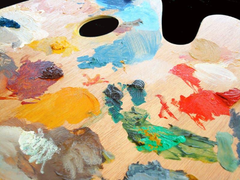 Het palet van Artistâs in gebruik stock foto