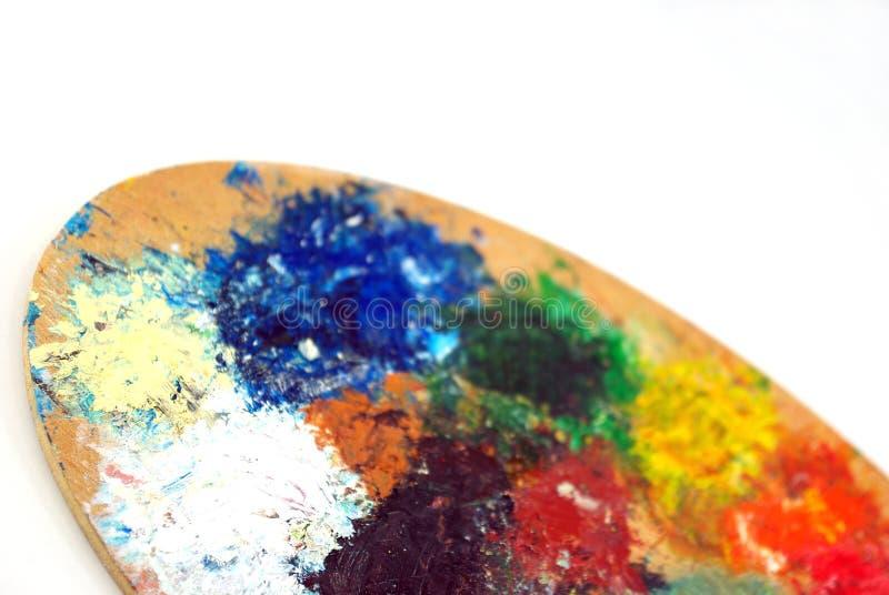 Het palet van de kleurrijke kunstenaar stock foto