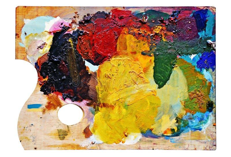 Het palet van de kunstenaar met vlekken van kleur royalty-vrije stock afbeeldingen
