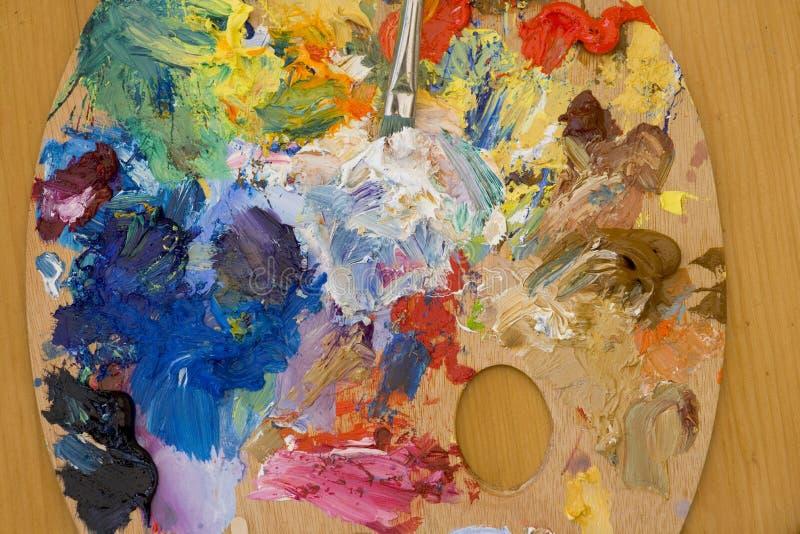Het palet van het kunstenaarsolieverfschilderij stock fotografie