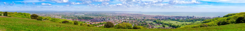 Het panorama van de de kusttoevlucht van Eastbourne van Zuiden wordt bekeken verslaat Manier N dat stock afbeeldingen