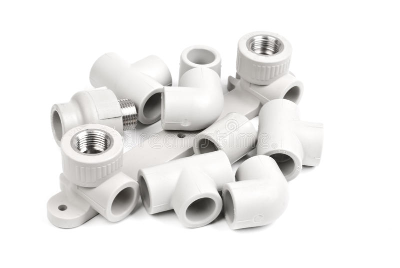 Het passen - pvc-verbindingskoppeling om polypropyleenbuizen aan te sluiten stock foto