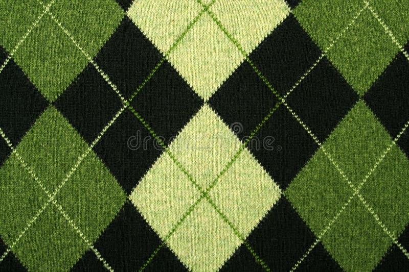 Het patroon van Argyle op een sweater stock foto's