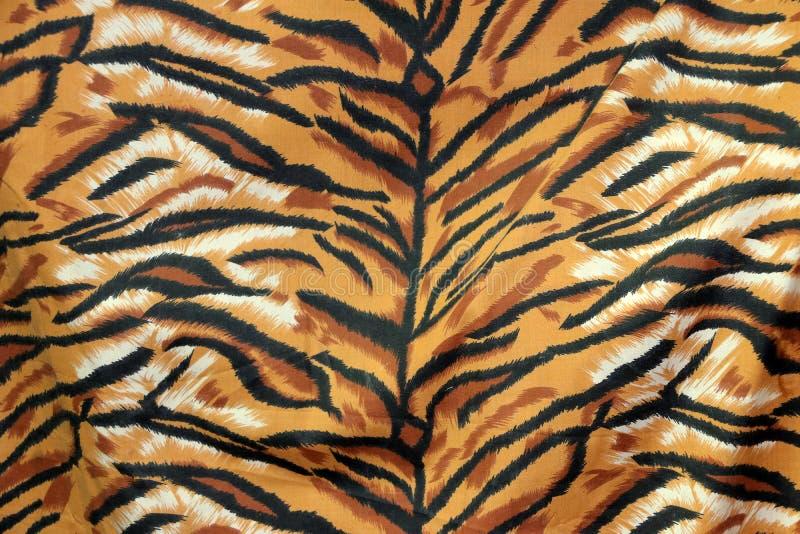 Het patroon van de close-upstof van koninklijke tijger of de tijger van Bengalen, in zwarte bruine sinaasappel en wit royalty-vrije stock foto's