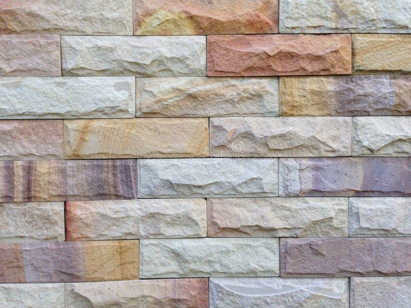 Het patroon van de zandsteenbakstenen muur en achtergrondtextuur royalty-vrije stock fotografie
