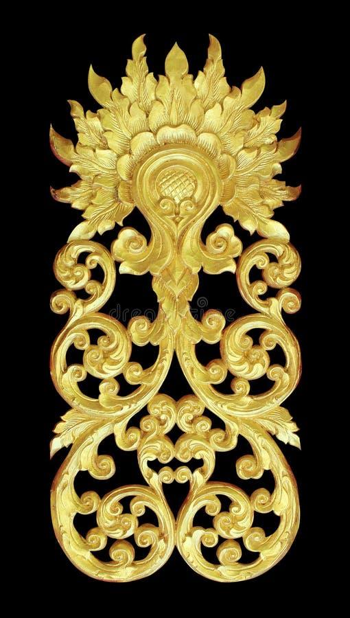 Het patroon van hout snijdt gouden verf voor decoratie op zwarte achtergrond royalty-vrije stock foto