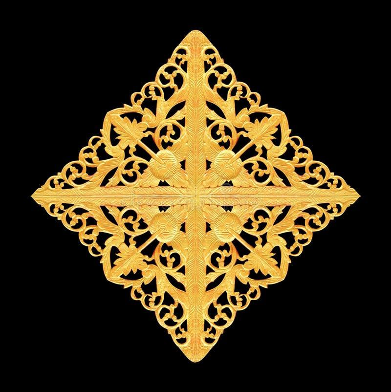Het patroon van hout snijdt gouden verf voor decoratie op zwarte achtergrond stock foto