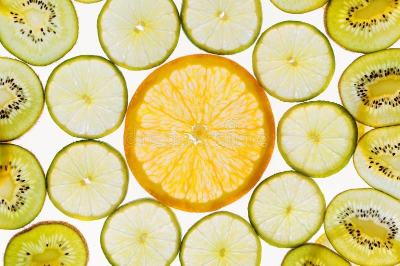 Het patroonachtergrond, sinaasappel, kalk en kiwi van fruitplakken abstracte stock fotografie