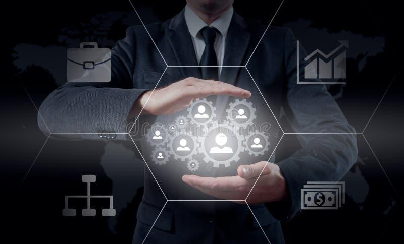 Het pictogramnetwerk van de hand dragend zakenman - het concept van u, van HRM, van MLM, van het groepswerk en van de leiding stock foto's