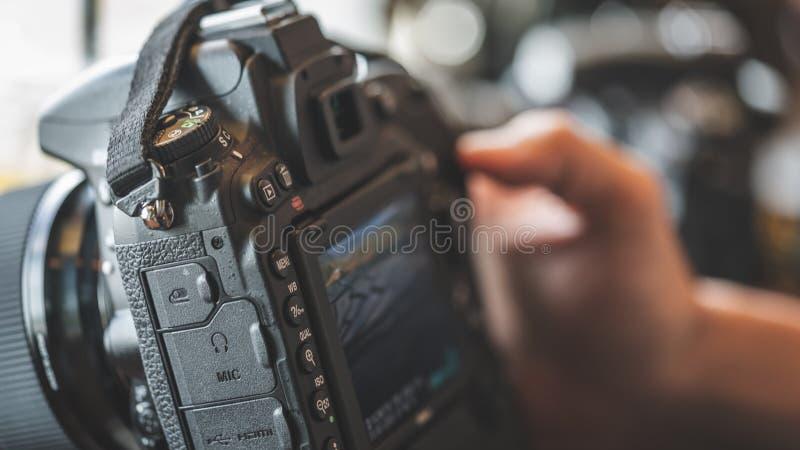 Het Plaatsen van fotograafcamera digital video Foto royalty-vrije stock foto