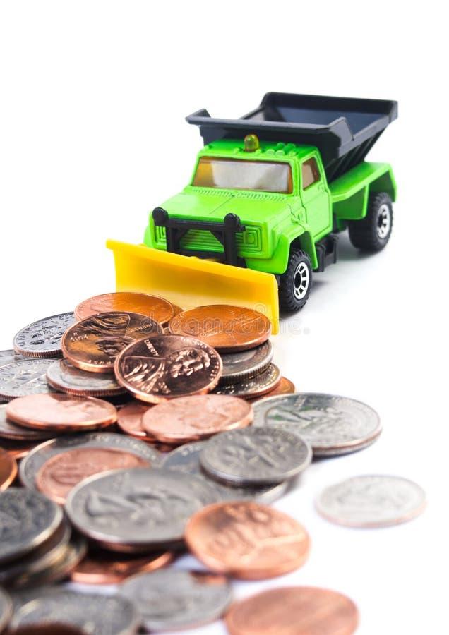Het ploegende geld van de stortplaatsvrachtwagen stock afbeeldingen