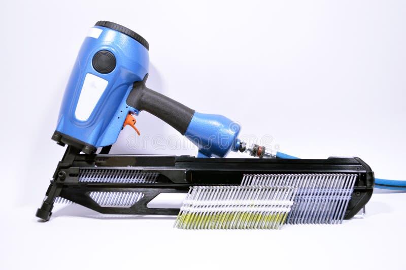 Download Het Pneumatische Kanon Van De Spijker Stock Foto - Afbeelding bestaande uit industry, isoleer: 114225872