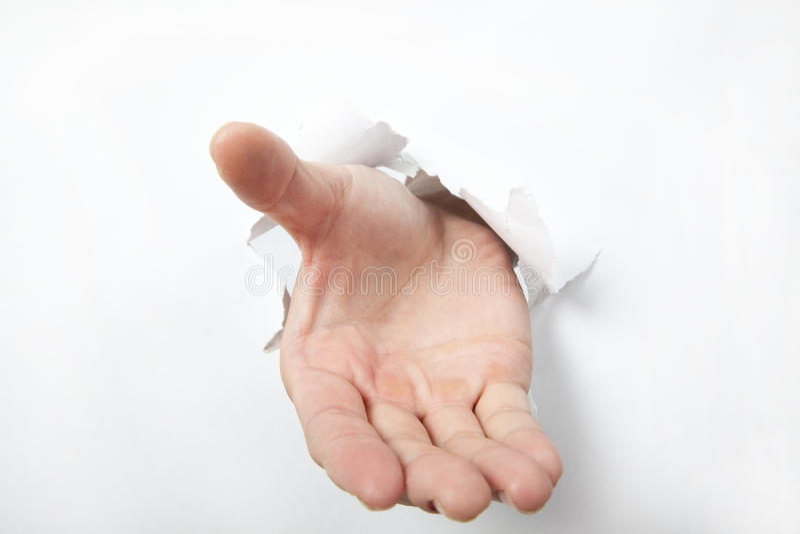 Het ponsen van de hand door Witboek en probeert aan shak stock foto
