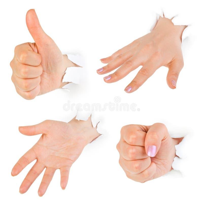 Het ponsen van handen door document stock foto