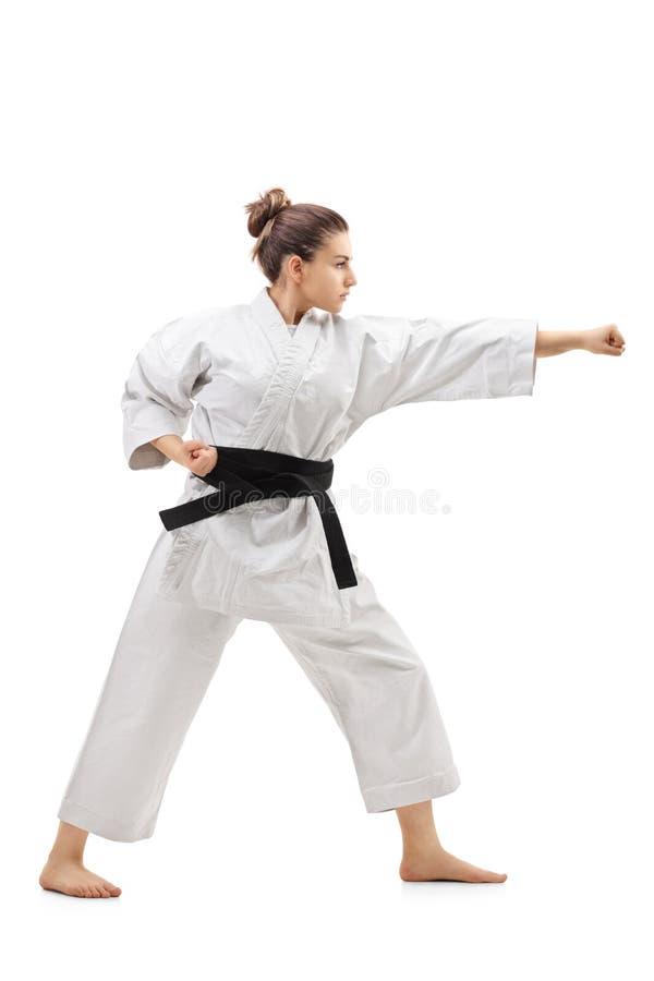 Het ponsen van het karatemeisje royalty-vrije stock fotografie