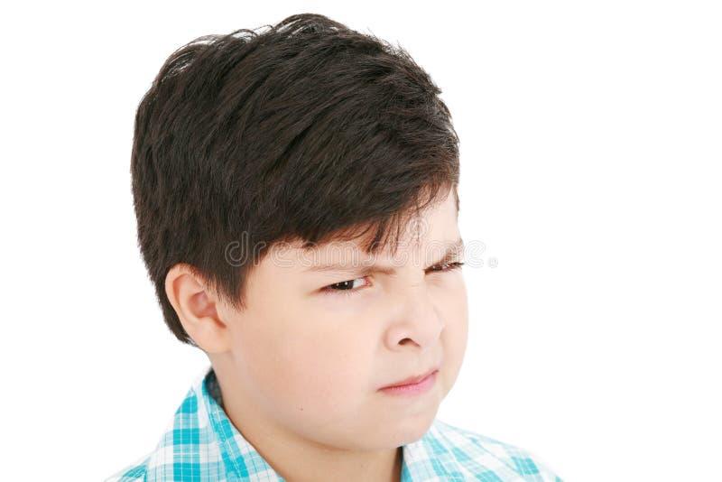 Het portret van de close-up van boos weinig jongen royalty-vrije stock afbeelding