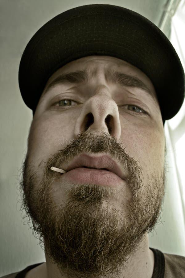 Het portret van de close-up van een arrogante mens royalty-vrije stock foto's
