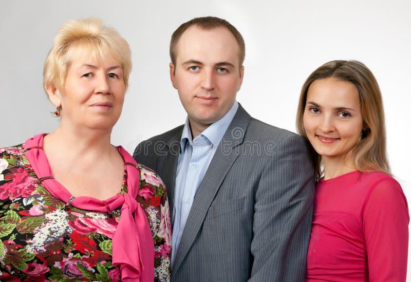 Het portret van de familie, grootmoeder, zoon, dochter stock afbeelding