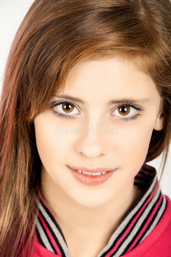 Het portret van de studio van jong mooi meisje stock afbeelding