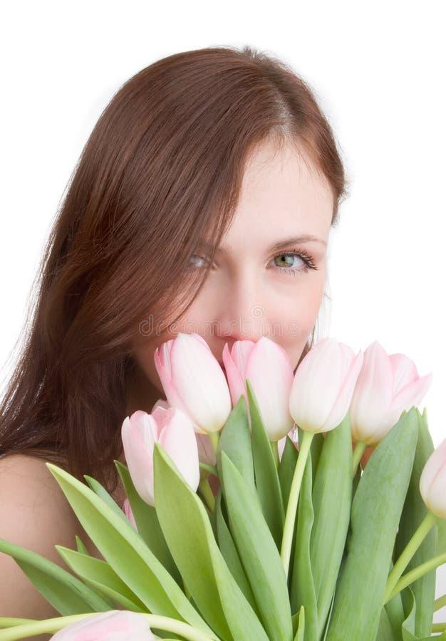 Het portret van de vrouw met tulpen royalty-vrije stock afbeeldingen