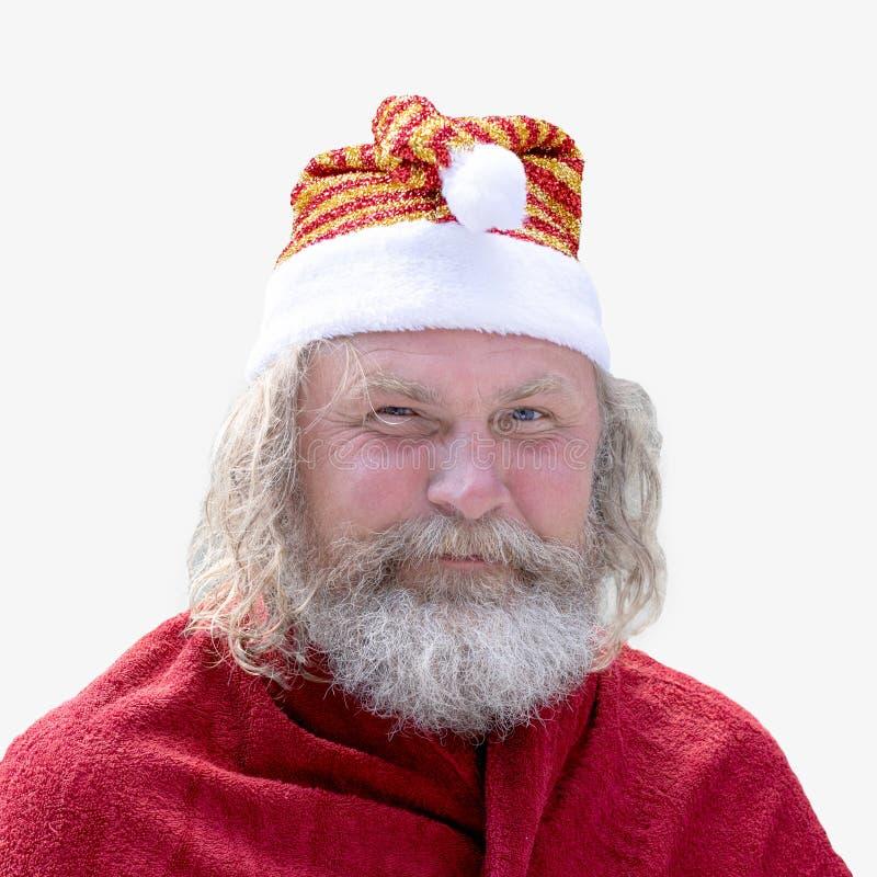 Het portret van een glimlachende charismatische hogere mens met een baard kleedde zich als Santa Claus royalty-vrije stock foto