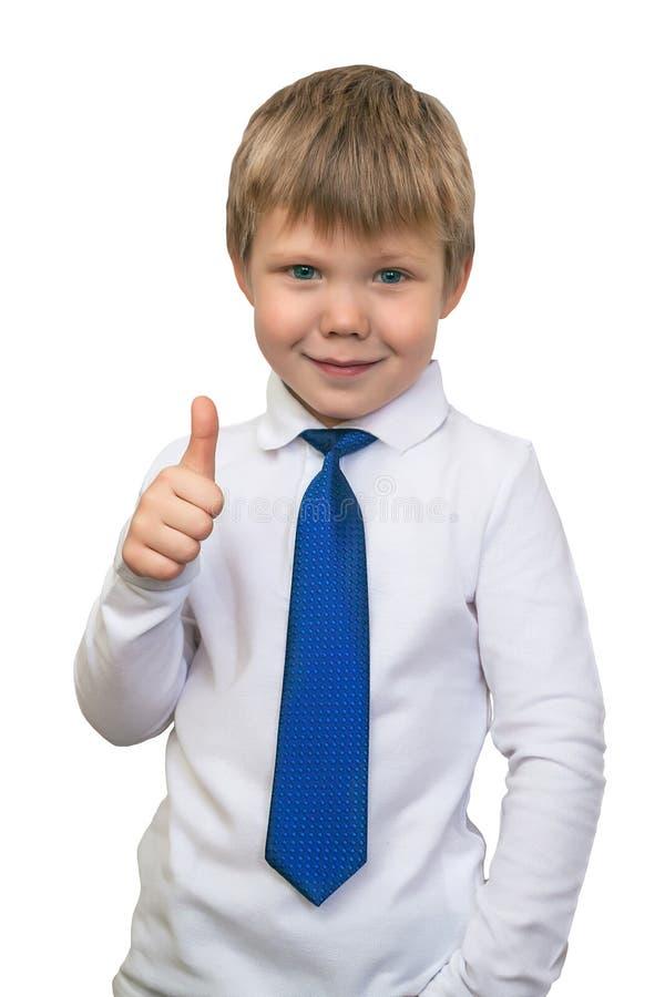 Het portret van het gelukkige die jongen tonen beduimelt gebaar, over w omhoog wordt geïsoleerd royalty-vrije stock afbeeldingen