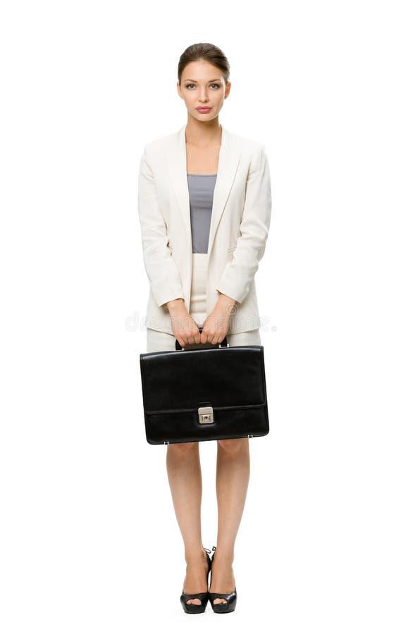 Het portret van gemiddelde lengte van bedrijfsvrouw met geval stock afbeeldingen