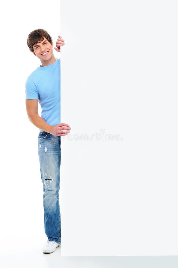 Het portret van gemiddelde lengte van de gelukkige mens met banner stock afbeeldingen