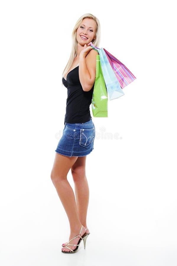 Het portret van gemiddelde lengte van vrouw met zakken stock afbeelding
