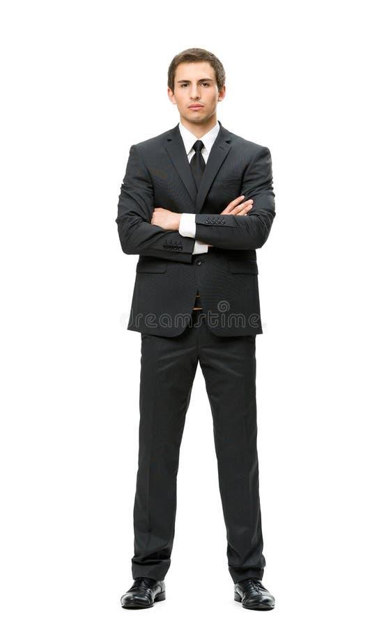 Het portret van gemiddelde lengte van zakenman met gekruiste handen stock foto