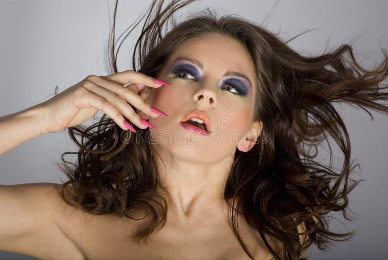 Close-upportret van mooie vrouw met professi stock foto