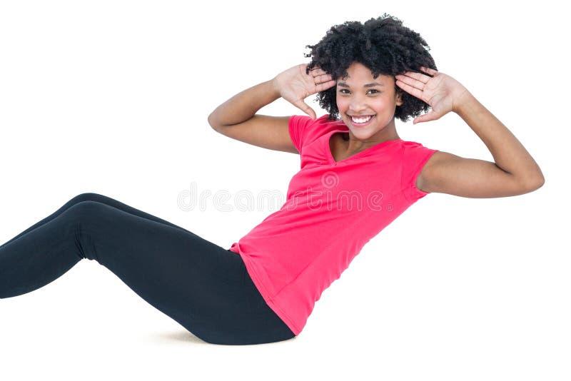 Het portret van het jonge vrouw doen zit UPS royalty-vrije stock afbeelding
