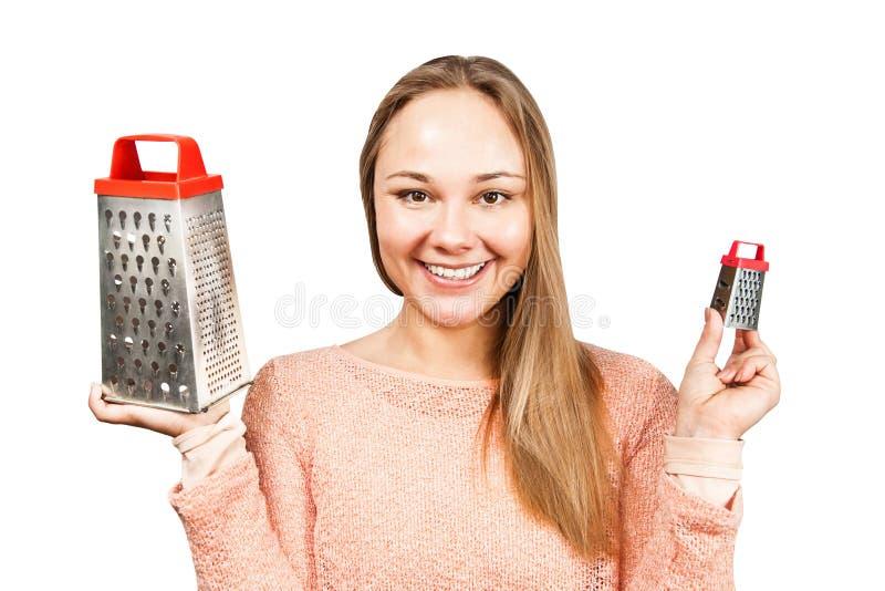 Het portret van jonge mooie vrouw houdt de rasp Ge?soleerdj op witte achtergrond stock foto's