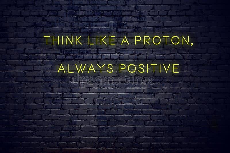 Het positieve inspirerende citaat op neonteken tegen bakstenen muur denkt als een proton altijd positief royalty-vrije illustratie