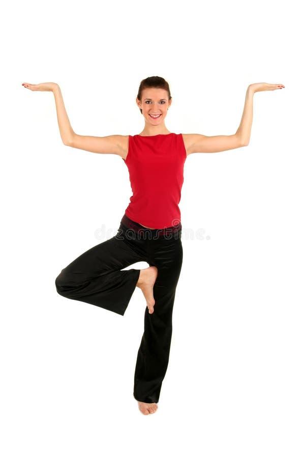 Het praktizeren van de vrouw yoga stock fotografie