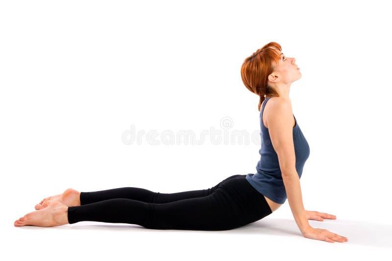 Het Praktizeren van de vrouw Yoga Asana stock foto